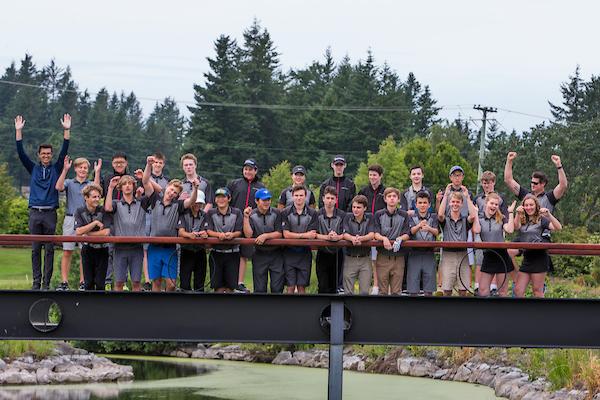Class photo on bridge