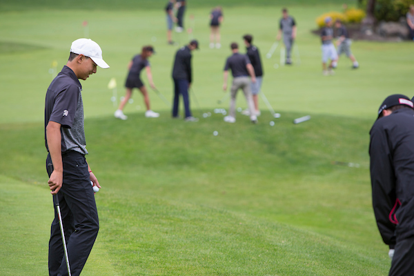 Players at chipping green